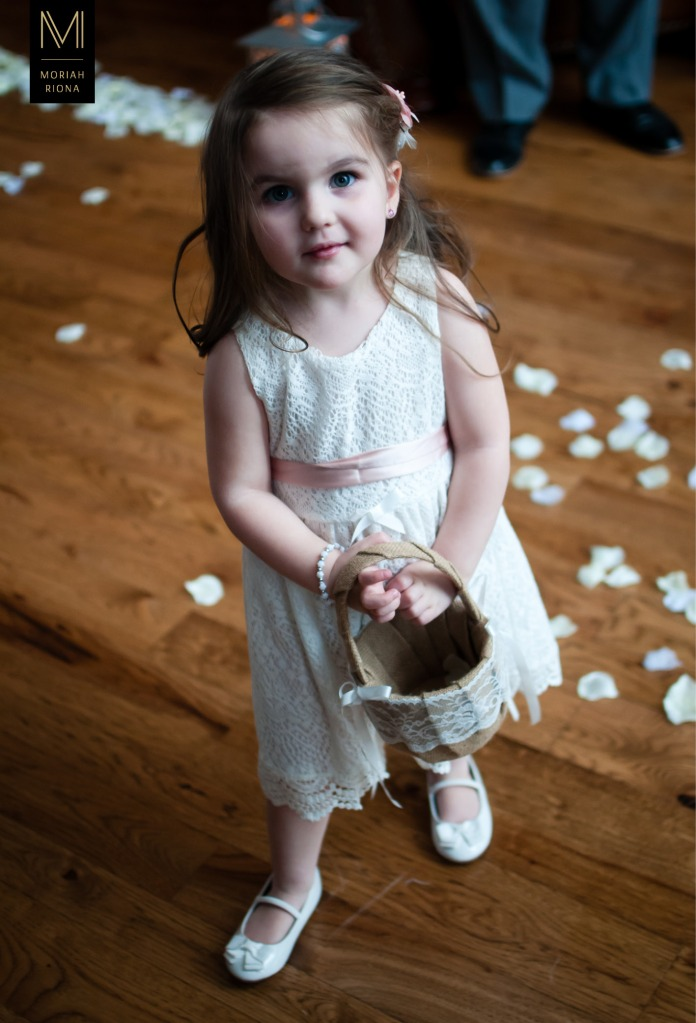 Adorable flowergirl in lace dress with pink sash | photography by Colorado Springs wedding photographer, Moriah Riona