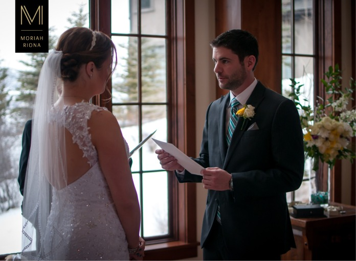Groom reads personal wedding vows during intimate ceremony in Vail, Colorado | © Moriah Riona, 2016