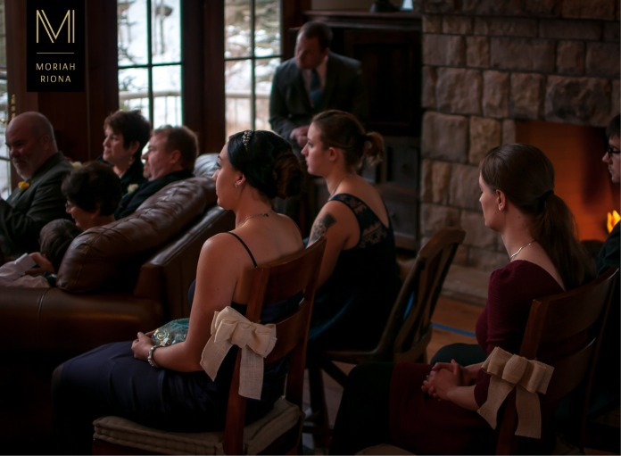Close friends and family watch as bride and groom exchange vows at private Vail residence | © Moriah Riona, 2016