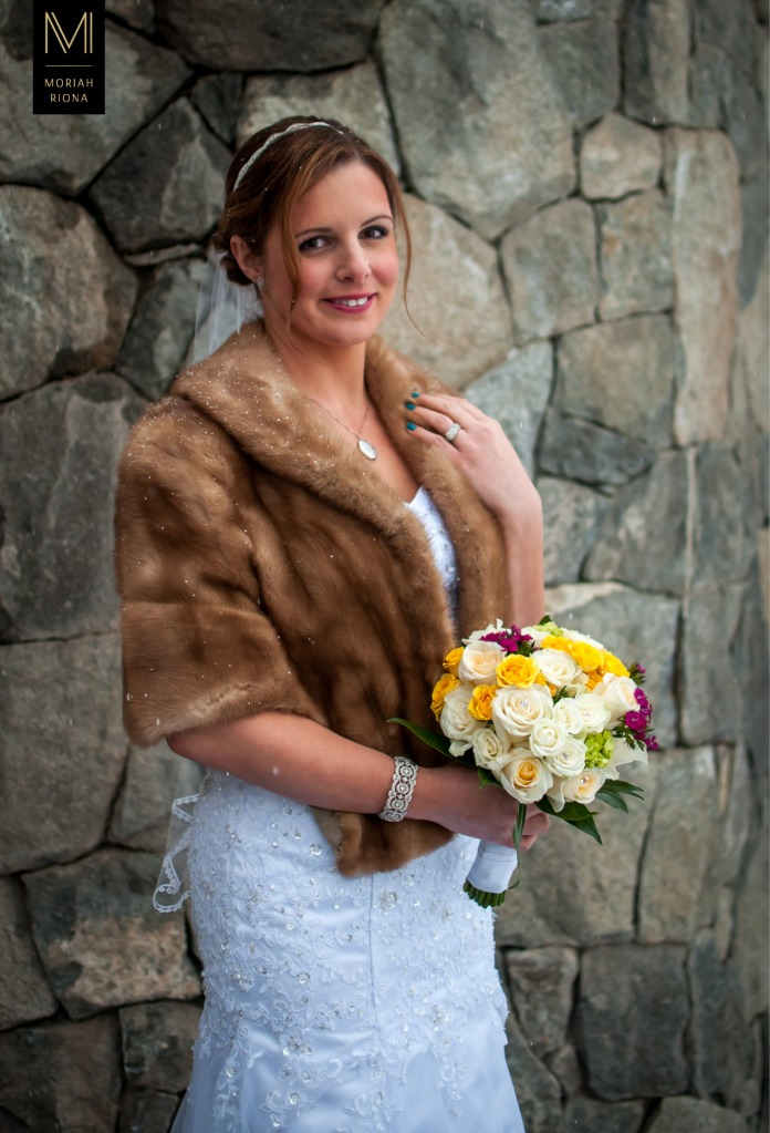 Bride in grandmother's fur with colorful DIY bouquet | Colorado winter mountain wedding | by Moriah Riona