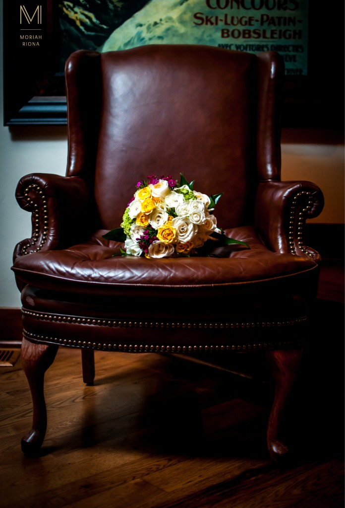 Wedding bouquet on leather chair in Vail, Colorado estate | Photography by Moriah Riona