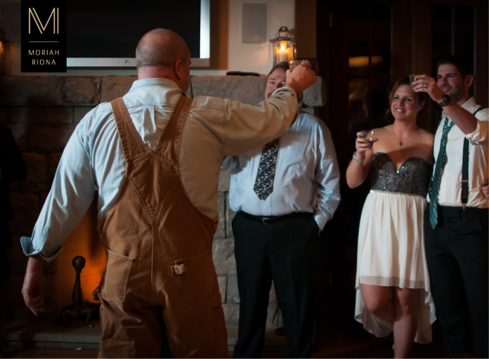 Groom's father raises a toast to the newly weds at intimate winter wedding in the Colorado mountains | © Moriah Riona, 2016