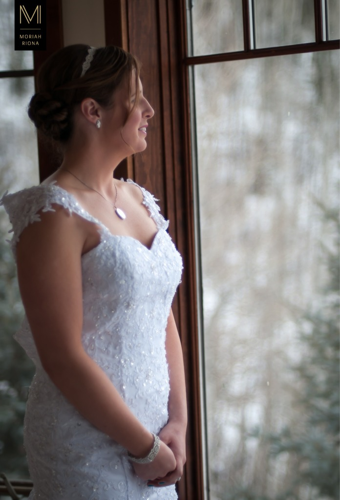 Beautiful bride staring out window of Vail estate | photograph by Moriah Riona, Colorado Springs Wedding Photographer